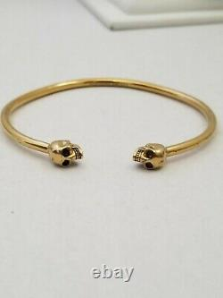 Alexander mcqueen thin twin skull bracelet Authentic gold plated