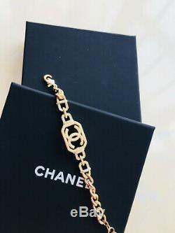 Authentic CHANEL Gold Logo Hoop Bracelet / AUTHENTIC (NIB)