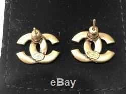 Authentic Chanel 2019 CC Logo Crystal Gold Tone Brass Earrings Studs Aged Finish