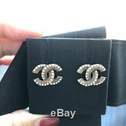 Authentic Chanel Antique Finish CC Logo Crystal Gold Tone Earrings Studs