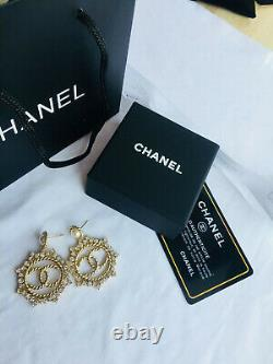 Authentic Chanel earrings CC logo hoop dangle RARE Round