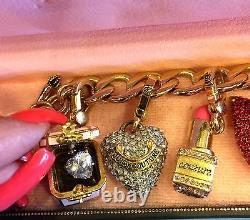 BEAUTIFUL Juicy Couture Charm Bracelet with 6 retired charms