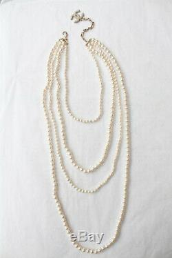 CHANEL Beautiful multi strands beaded necklace with CC logo
