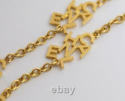 CHANEL Logo charm Necklace 35 inch long Gold Tone Vintage Authentic k523