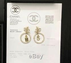 Chanel gold double CC logo motif crystal embellished stud pierced earrings