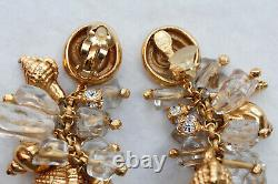 Christian Dior Lovely gilted metal drop clip on earrings with shell charms