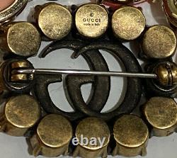 Gucci Metal gold Finish Red crystals Double G detail Pin in metal1.25W x 1