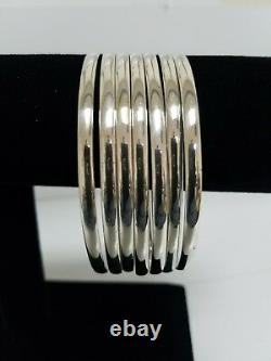 Weekly 7 Silver bangles with coins 925. Silver semanario